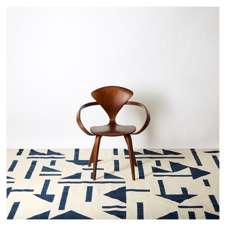 Designed exclusively by The Conran Shop, this Triangle Tile Dhurrie Rug in ivory and blue hues is handwoven and crafted from 100% cotton.