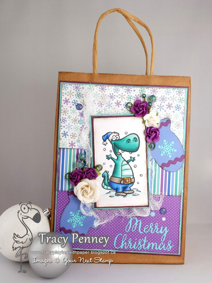 Stamp: Dino-Mite Holiday (Your Next Stamp) Dies: Winter Mitten, Christmas Words (Your Next Stamp) Paper: Doodlebug Frost Friends Other: Gumdrops, Recollections Flowers (Michaels), cheese cloth Ink: Memento Tuxedo Black, Walnut Stain Distress Ink, Copic Markers