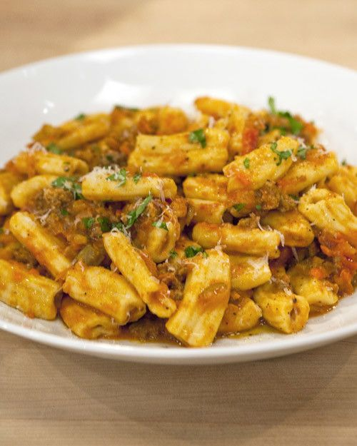 Fulfill your pasta craving with a plate of delicious homemade rigatoni bolognese.