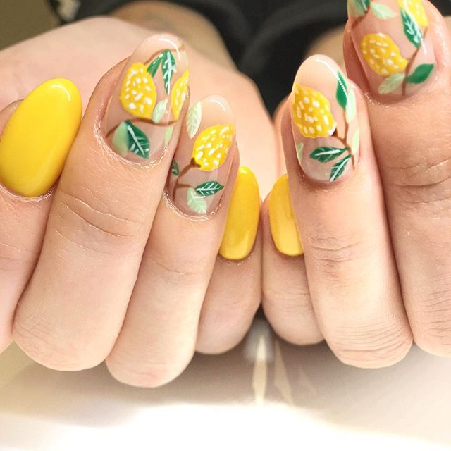 Lemon Nail Art Is Truly Thriving This Summer So Get On It These Lemons Are Set On Top Of Short Almond Shaped Nails With Bright Lemon Nails Nails Nail Designs