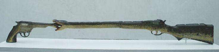 Iris Schieferstein - Friends (Toy gun, toy rifle, snakes, 35 x 5 x 9 inches), 2009.