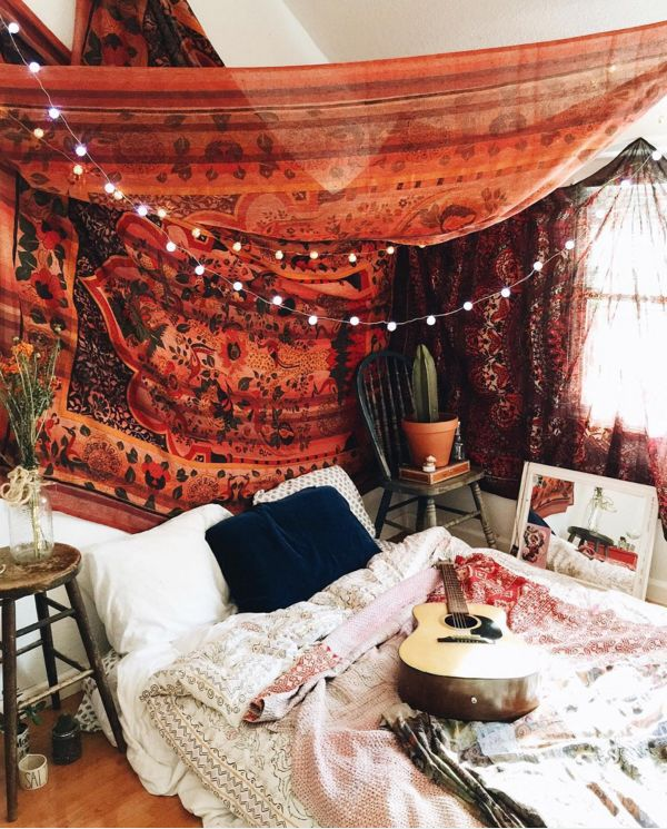 "Multiple tapestries hung haphazardly on ceiling and wall.  urbanoutfitters: ""Via uosanfrancisco. """