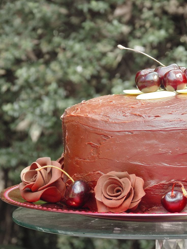 Chocolate cake with cherries and edible chocolate Fondant roses