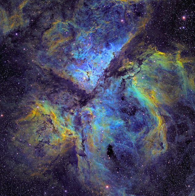 Celestial Emissions - Eta Carina Nebula by strongmanmike2002. Glowing regions of gas in our galaxy are known as emission nebulae. Imaging these nebulae through filters that only allow the passage of very specific wavelengths of light produces this type of image.