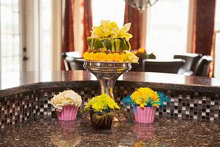 """Each of these cute """"cupcake"""" floral designs is monobotanical and monochromatic. Monobotanical flowers, all one variety, are a great way to get a simple and elegant look. Roses, tulips, gerbera daisies, carnations, even babies breath look wonderful when displayed all on their own."""