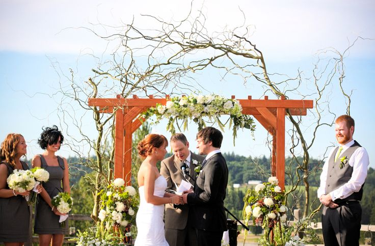 using branches to decorate outdoor wedding chairs | An arbor decorated with flowers and branches creates a lovely place to ...