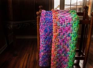 Three strands of yarn, a giant hook, and the basketweave stitch. Easy stashbuster blanket. by Katybug