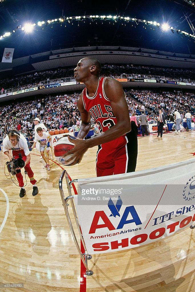 big sale 9c0a6 77039 MIAMI - FEBRUARY 10. Michael Jordan  23 attempts a shot during the 1990 NBA  All-Star Three Point Contest on February 10, 1990 at Miami Arena in Miami  ...