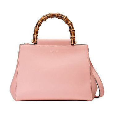 """Nymphea leather top-handle bag by Gucci. Double bamboo top handles with pearly side studs, 3"""" drop. Removable shoulder strap, 17"""" drop. Open top. Goldtone har..."""