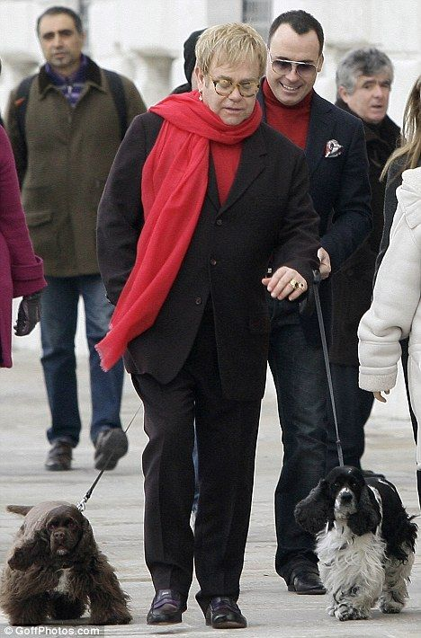 Elton John David Furnish Dog Arthur | Elton John's fashion sense runs out on him as he sports a tracksuit in ...