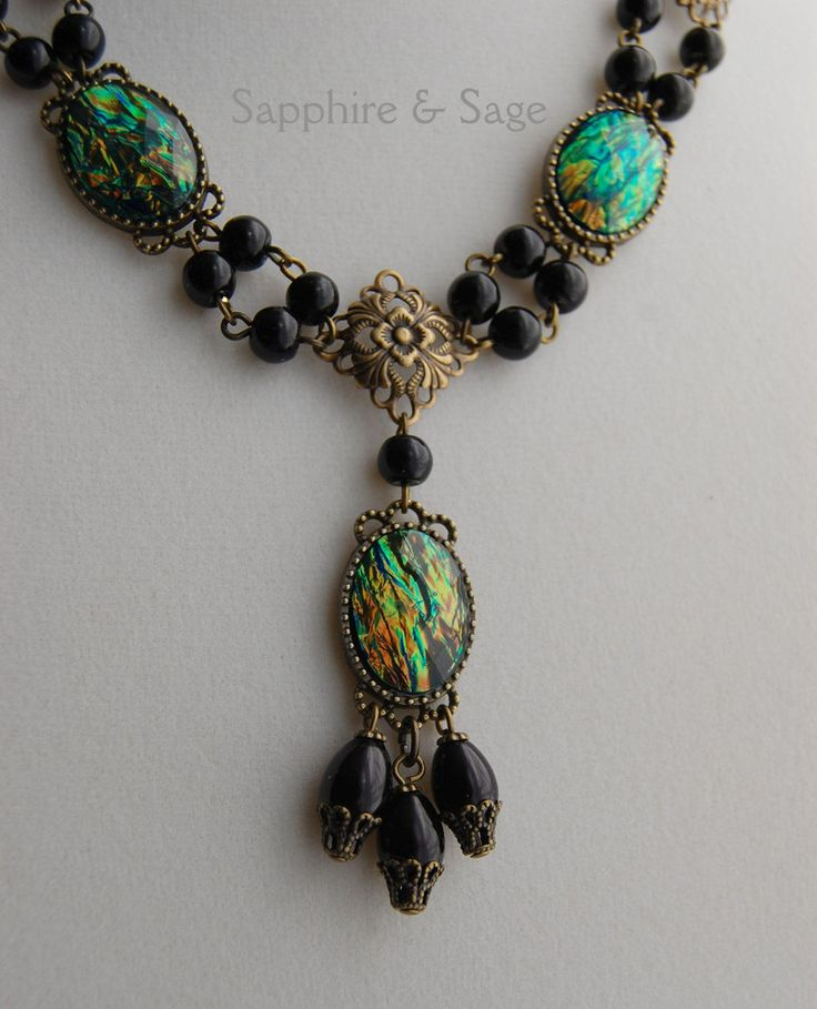Cordelia Renaissance Edwardian Victorian Necklace in Dragon Scale Stones www.sapphireandsage.com  Dark and demure, moody and mysterious! Faceted acrylic stones gleam with color-changing brilliance in antiqued-patina settings, with hand-wired capped glass pearl drops.