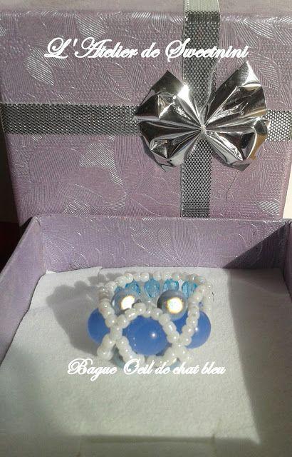L' Atelier de Sweetnini: bague avec des perlesde rocailles, des perles magques, des olives bleues facetées et oel de chat bleu ciel