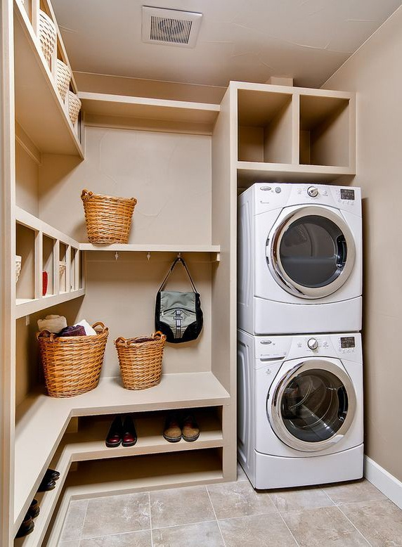 A laundry/mudroom combo! Does this tickle your fancy? A Central project manager can help you put custom shelving like this in your home!