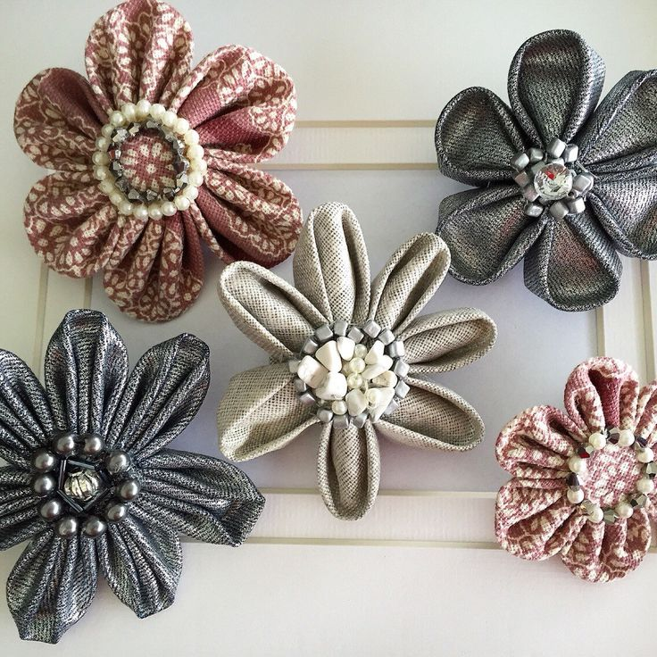 A personal favourite from my Etsy shop https://www.etsy.com/au/listing/212534895/kanzashi-flower-brooch-with-handmade