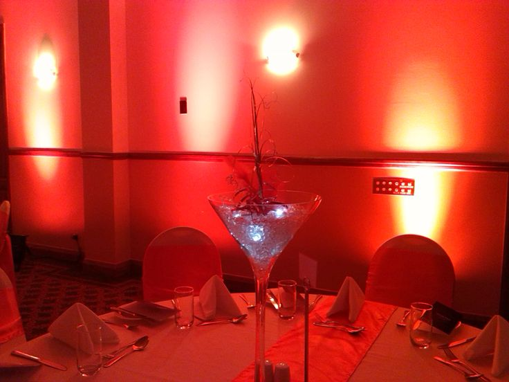 Red lit uplights accompaning martini centerpiece. NZICA Xmas Function 2013