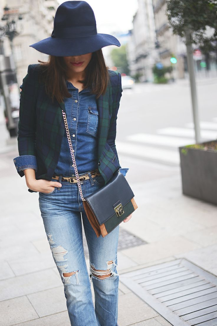 Step up your off-duty look in a navy and green plaid blazer and blue distressed slim jeans.  Shop this look for $176:  http://lookastic.com/women/looks/hat-denim-shirt-crossbody-bag-blazer-belt-skinny-jeans/4477  — Navy Wool Hat  — Blue Denim Shirt  — Navy Leather Crossbody Bag  — Navy and Green Plaid Blazer  — Tan Leopard Leather Belt  — Blue Ripped Skinny Jeans