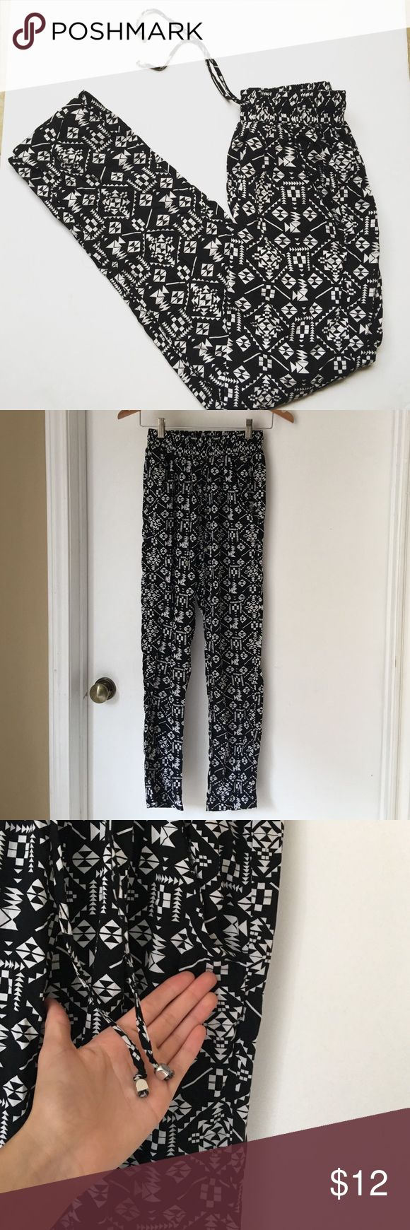 Tribal print palazzo pants Have cute tribal print . The waist is stretchy and has a drawstring with beads at the end of it has two pockets in the front and 2 in the back the ones in the back are sewed together these pants are very cute yet comfy dress them up or down  there gently used Cotton On Pants Track Pants & Joggers
