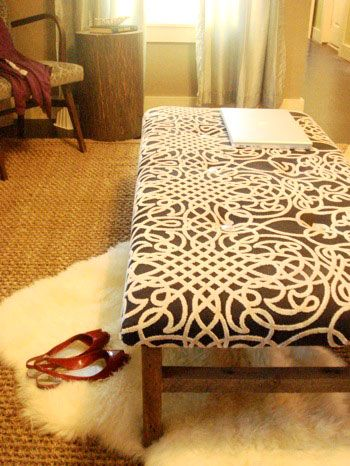 A great way to reuse that coffee table with the bad top. Maybe at the foot of the bed in the guest bedroom.