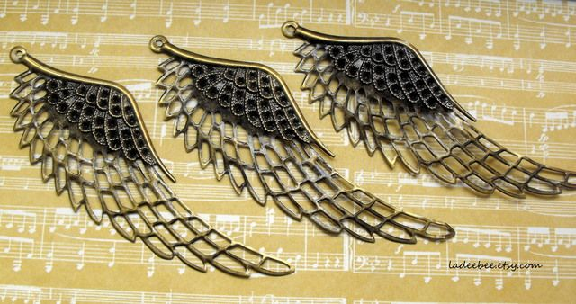 Large Wing Pendants. Starting at $1 on Tophatter.com!