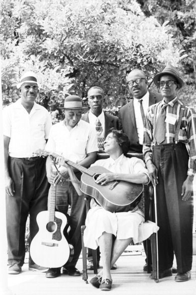 Blues greats (L-R) Yank Rachel, Mississippi John Hurt, Skip James, Elizabeth Cotten, Doc Reese and Sleepy John Estes pose for a portrait at the Newport Folk Festival in July 1964 in Newport, Rhode Island by David Gahr