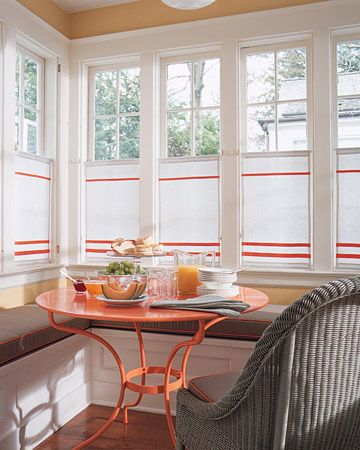 oh my! love this! the orange wall color, that table, the curtains! swoon!