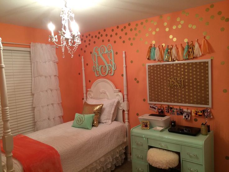 Pre-teen girl bedroom makeover. Coral & Mint bedroom with Gold accessories. Wooden monogram, monogrammed pillow, vinyl gold wall dots, monogrammed jewelry dish, gold glitter desk cup & tassel garland purchased from Etsy. Chandelier. Vintage desk & stool makeover. Shabby Chic decor.