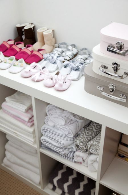 organized nursery closet. I have two of these Ikea shelves