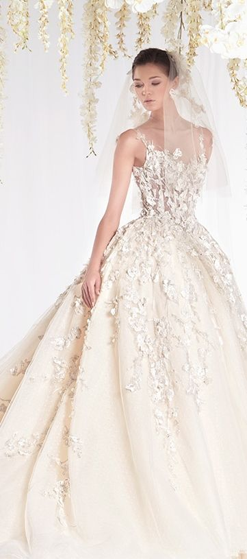Love the applique on this dress, heavier on the top and flowing down ,Ziad Nakad 2015 Haute Couture Bridal Dress