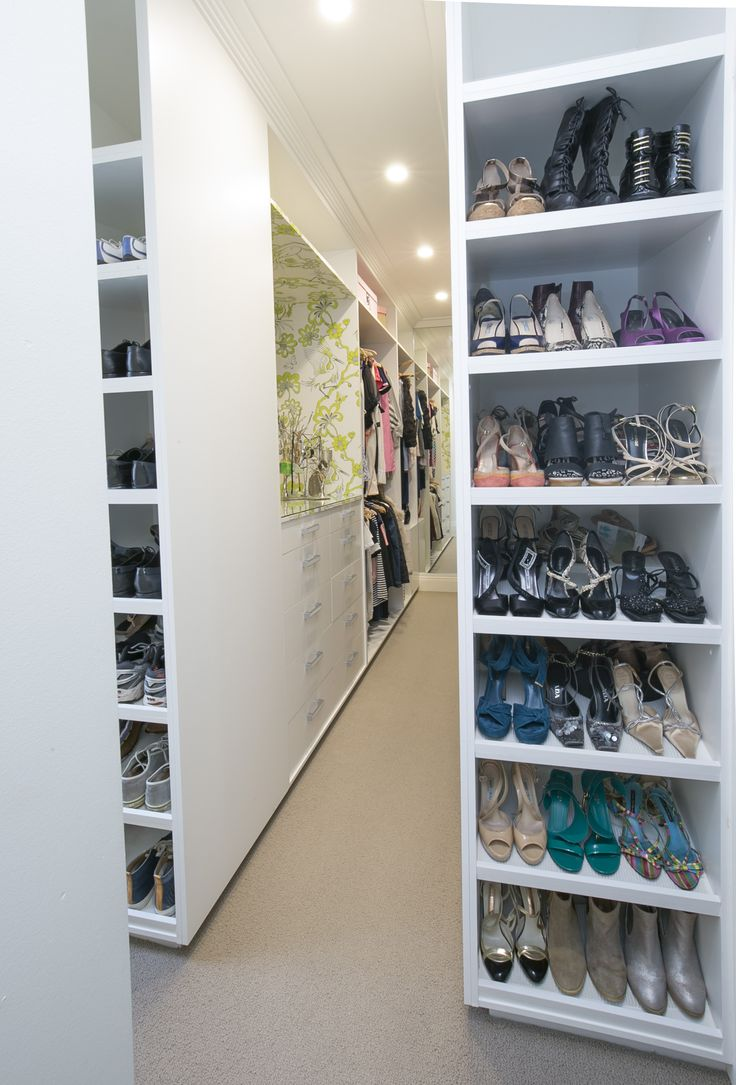 Walk in Wardrobe with Signature Prints Wallpaper and bespoke shoe racks. Brooke Aitken Design