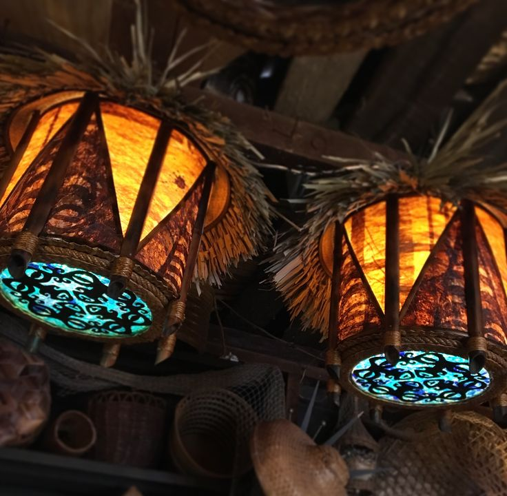 Pair of thatched tapa lamps with Marquesan tiki and sea glass bottom.