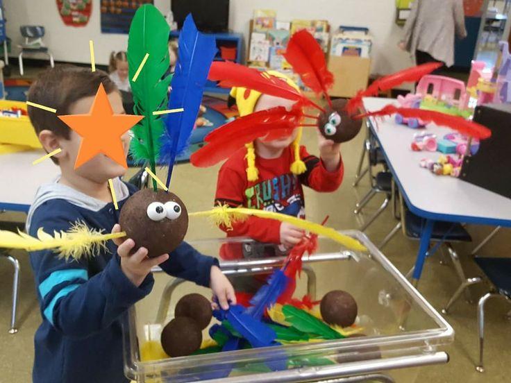 Turkeys in the sensory table. Orange tinker toys, feathers,  Mr. Potato Head eyes.  Fun, fun.