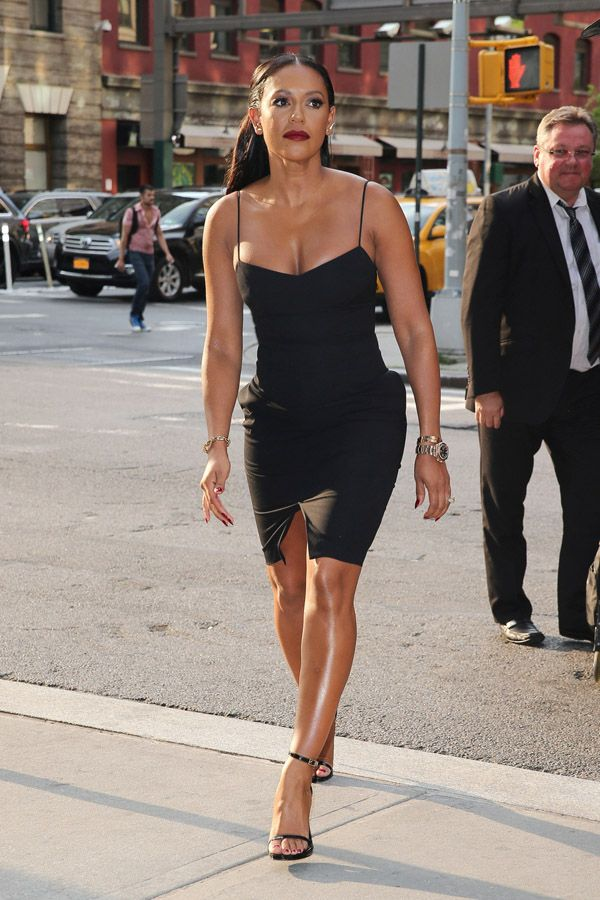 Melanie Brown arrives at her hotel wearing chic black dress, after her appearance at The Tonight Show Starring Jimmy Fallon in New York City