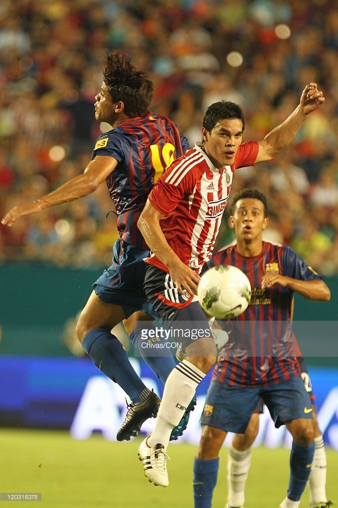 Barcelona vs Chivas. Midfielder Xavier Baez of Chivas (R) struggles for the ball with Jonathon dos Santos of Barcelona (L) during an International Friendly match at Sun Life Stadium as part of World Football Challenge 2011 on August 3, 2011 in Miami, Florida USA.