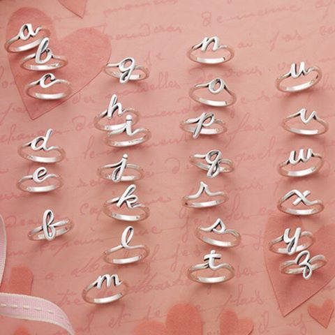 Compose a love letter with our new sterling silver Script Initial Rings. Wear one or stack many! #JamesAvery  Click the link in our profile to shop this ring!