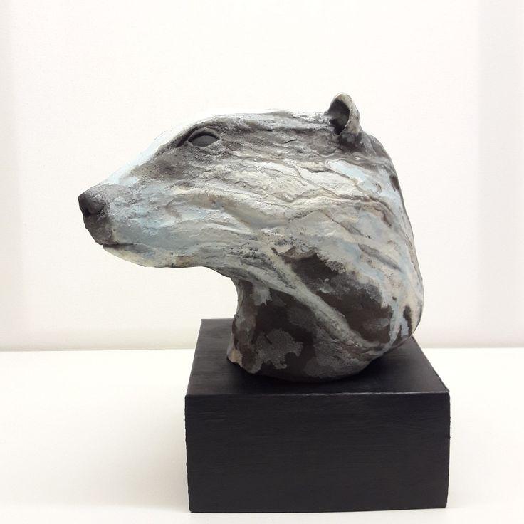 Badger . Black stoneware badger with applied slips. Kevin Harrington