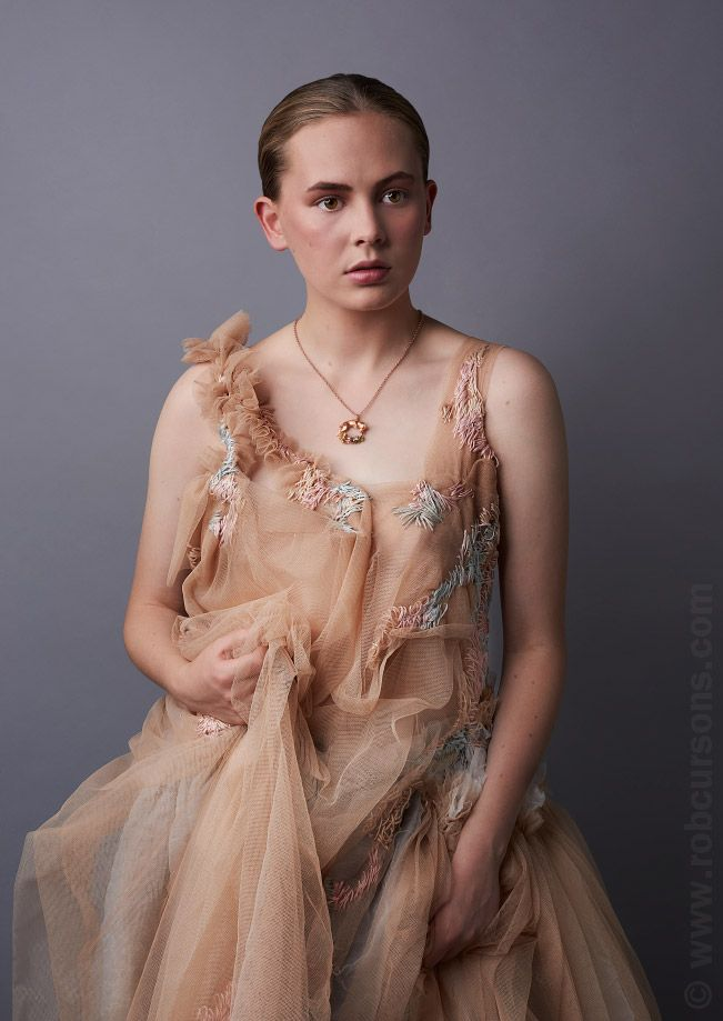 Foxes collection with model Emilia Smith wearing a fox necklace