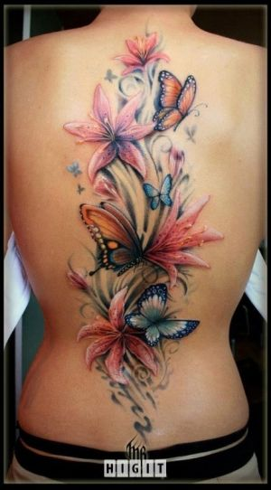 These flowers and butterfly are beautiful. I think it would look a little better if it wasn't quite so straight up the back though, maybe curved (just my preference).