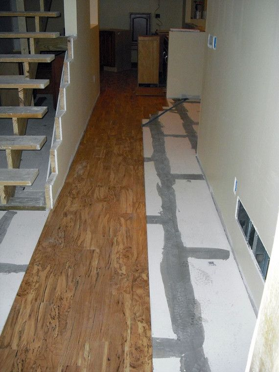 Linoleum flooring that looks like wood goes down over the for Linoleum flooring wood look