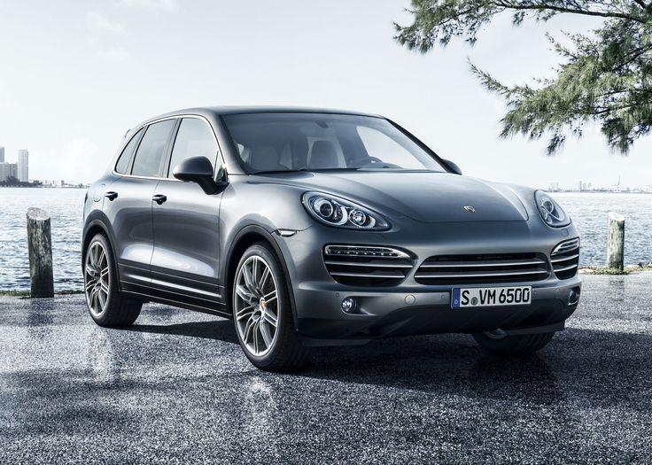 My husbands Porsche Cayenne, grey exterior, black leather interior.