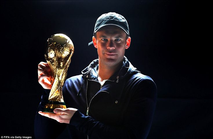 Bayern Munich goalkeeper Manuel Neuer poses with the World Cup as part of the proceedings at the ceremony in Zurich