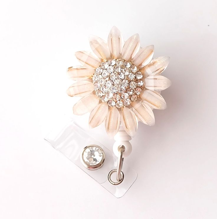 Gold Sunflower Bling - Pretty Badge Holder - Bling Badge Reel - Stylish ID Badge Clip - Nurse Jewelry - Teacher Gift - RN Badge BadgeBlooms by BadgeBlooms on Etsy https://www.etsy.com/listing/194478972/gold-sunflower-bling-pretty-badge-holder