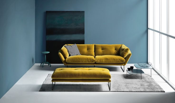"""This cool mustard Italian sofa attracts something desirable with the hexagonal shape resting on slim steel rod feet with the option of customisation with a black chrome, gloss chrome or white power coated finish. The Saba New York suite is soft to the touch, you can feel yourself melt in """"awe"""" The New York Suite is available in smaller versions such as 155 cm, 190 and 260 cm which seats two people comfortably on the 155 and is particularly interesting for contract projects."""