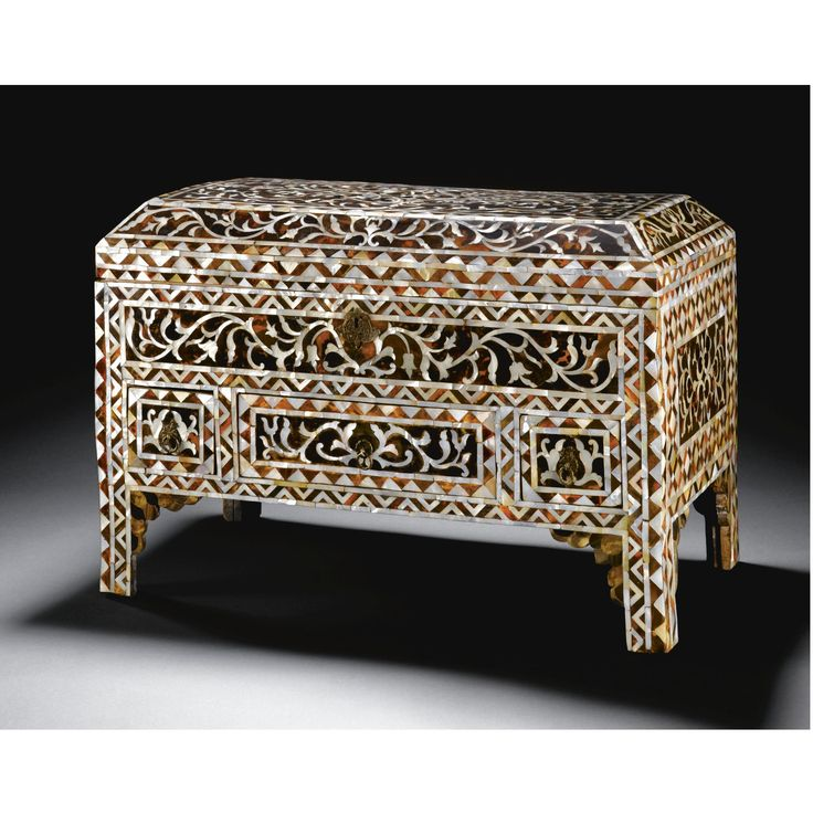 An Ottoman Mother-of-Pearl Inlaid Box, Turkey, 18th Century of rectangular form standing on bracket feet, with a sloping hinged lid, covered throughout in tortoiseshell and decorated with floral and palmette sprays in mother-of-pearl inlay, the front panel with pierced silver lock plate and two small drawers flanking a longer central one, side and rear floral panels against a trellis ground 59.5 by 40cm.