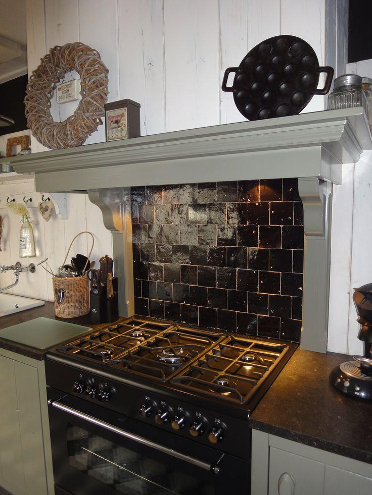 Dark tiles behind a black stove - a subtle reminder of old times