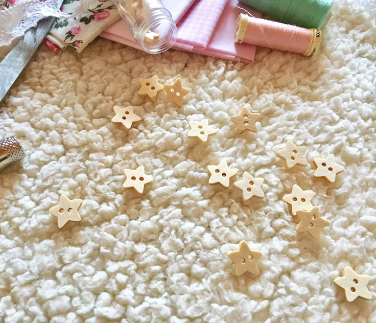 A personal favorite from my Etsy shop https://www.etsy.com/listing/494200464/6-beige-star-shaped-wooden-buttons