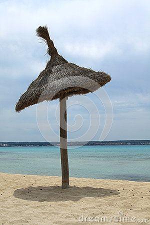 Lonely sunshade on an empty beach of Playa de Palma. Mallorca, Spain