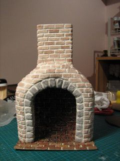 mini fireplace made by draping air dry clay over foam board base & then…