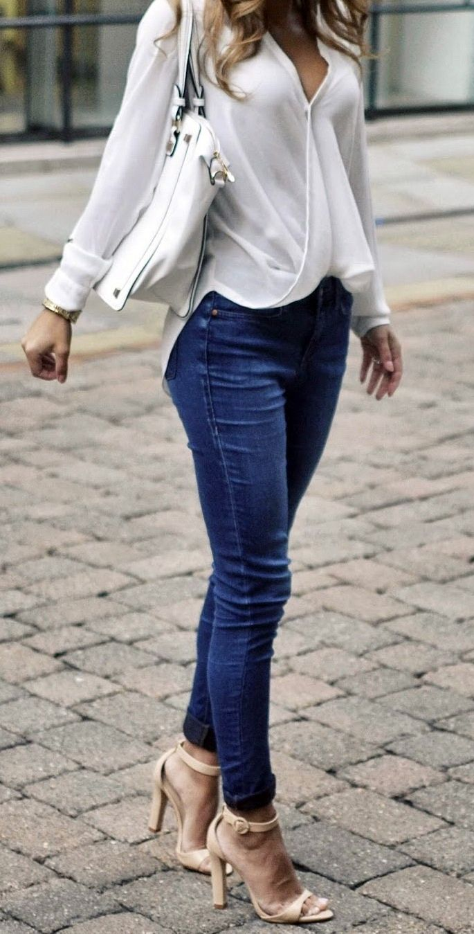 Nada Adelle wears denim skinny jeans and cute white wrap blouse. Top: River Island