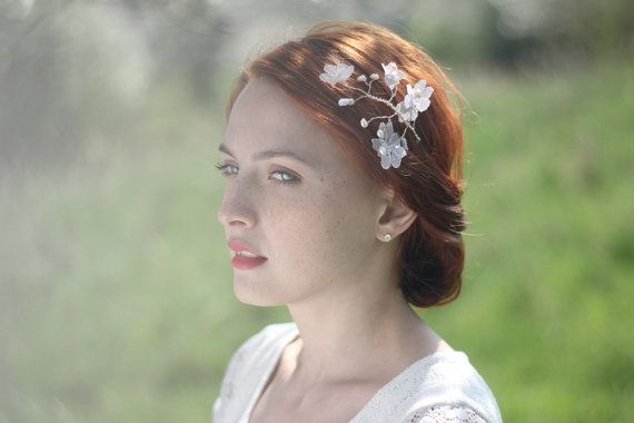 Bridal hair pin - this flower hair pin is completely wired by hand with attention to detail. This woven floral headpiece is made with handmade lace