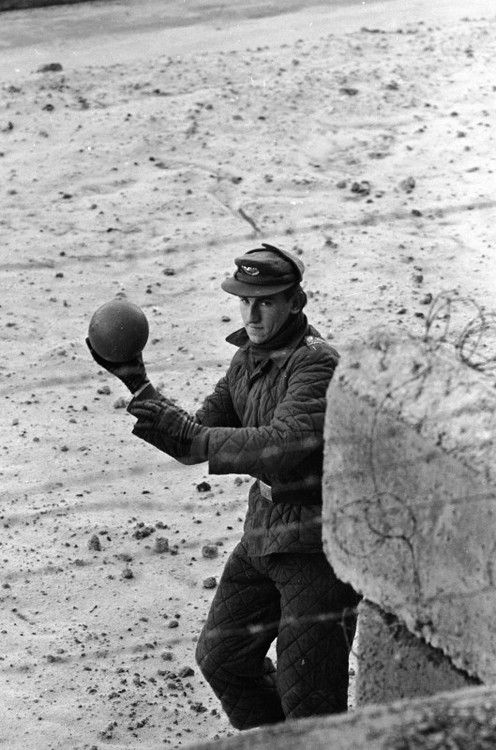An East German border guard tosses a ball back over the Wall after a West German child mistakenly threw it over. Berlin, 1962.   Paul Schutzer ~ the cold war